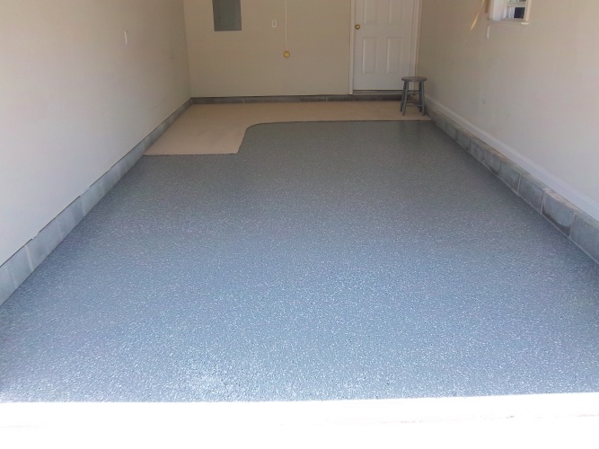 After: garage floor painted gray with flakes