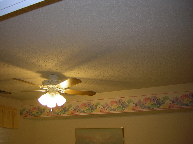 Before: crumbling popcorn ceiling needs to go
