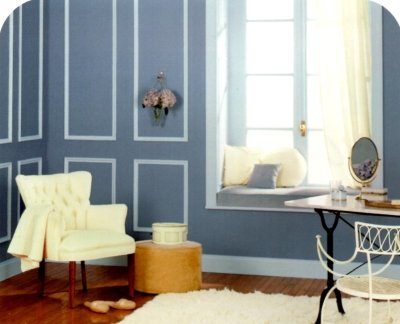 Dusty blue walls with pale blue decorative trim in a classy decor