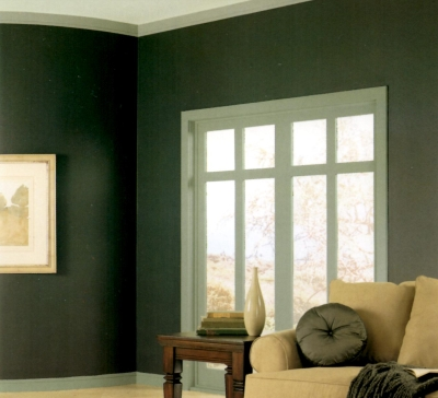 Different shades of green used on the walls and woodwork