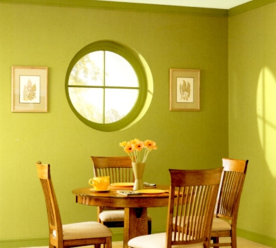 Yellow-green walls, window and trim in a dining room