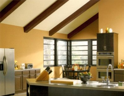 Black and brown trim color with warm neutral walls in a kitchen