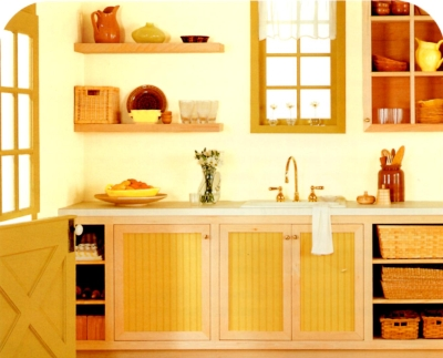 Mustard yellow trim in an earthy kitchen color palette