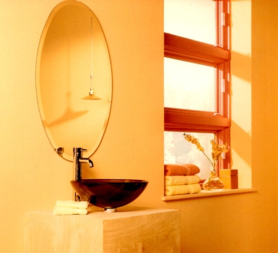 Orange bathroom window against apricot colored walls