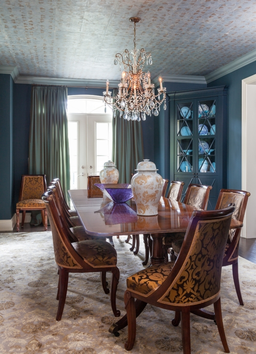 Dining room painted teal and decorated with gold and green