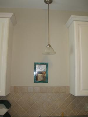 Kitchen wall area above the sink