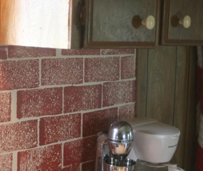 Faux brick finish created with a kitchen sponge