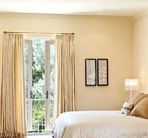 Using the wall color on crown moldings makes ceilings look higher