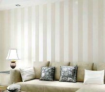 Vertical wall stripes visually elongate the walls