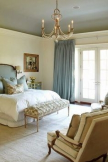 To lower a ceiling, paint it darker than the walls