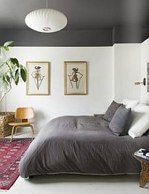 Bring the ceiling closer by dropping its line down the walls