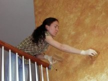 Yelena is faux painting a wall