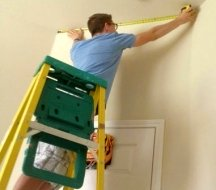 Measure the walls in inches to lay out the stripes properly