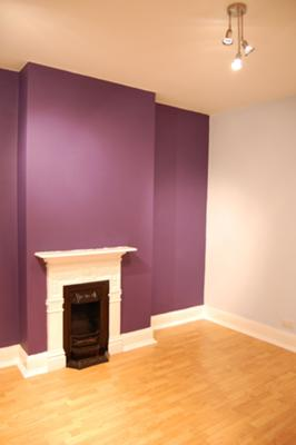 Rich violet colour feature wall in my bedroom for Purple feature wallpaper living room