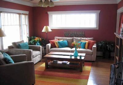 Spicy dark red wall color in a mediterranean room color scheme for Pumpkin spice paint living room
