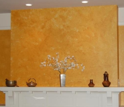 Fireplace wall with a sponged on paint finish