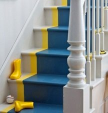 A wide painted strip of color on the stairs can look like a runner