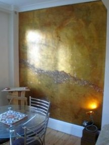 Metallic paint finishes can be combined for unique accent wall designs