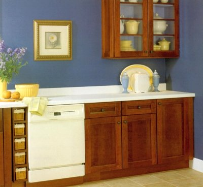 Orange stained kitchen cabinets with blue wall color