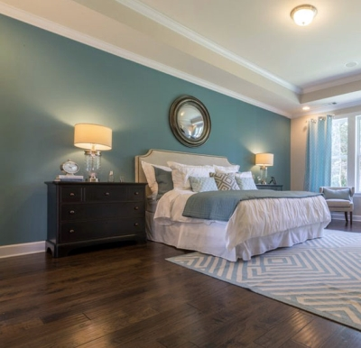Blue-green wall paint color with brown wooden flooring